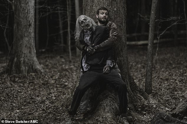 Nice shot: Felix held onto a zombie that Iris killed with her bow and arrow