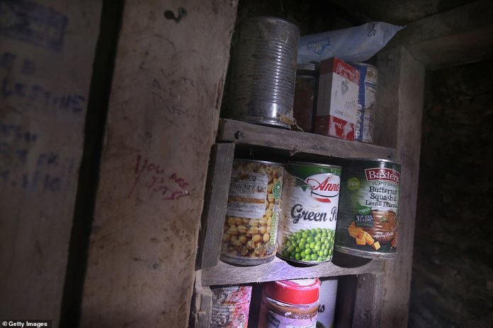 Tinned goods and a pack of cards have been put in one of the many storage sections inside one of the tunnels at the site
