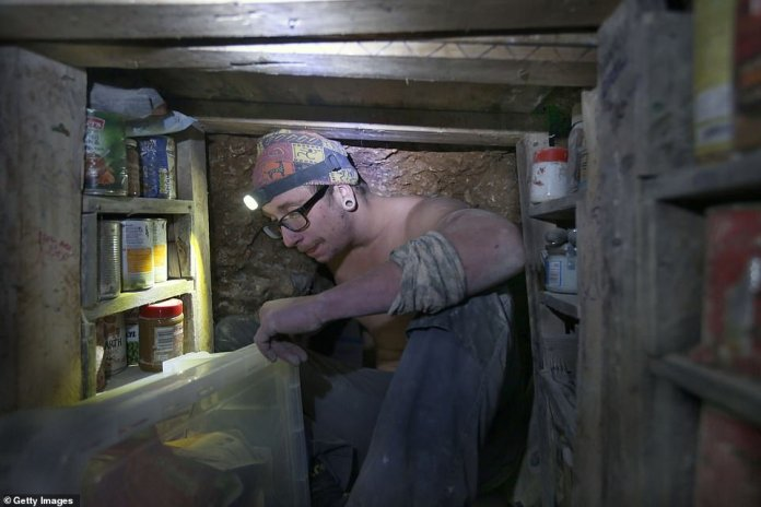 An activist brings eviction provisions in a covered rat-proof box and puts it in a chamber ahead of attempts to force eviction