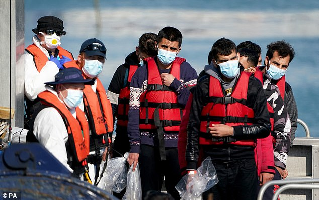 A group of migrants being brought ashore at Dover this weekend
