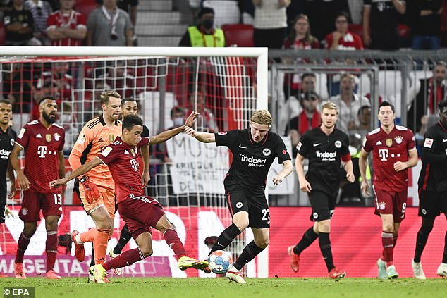 Bundesliga clubs have encouraged their players to get jabbed against coronavirus with some success. Pictured is the recent game between Bayern Munich and Eintracht Frankfurt