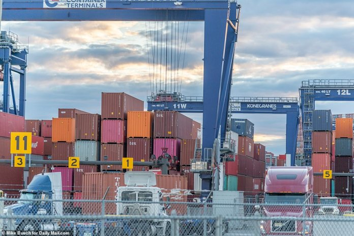Workers in shipping yards cannot work quickly enough to unclog the jams. Above, workers at the Port Jersey terminal on Sunday work frantically to load goods onto trucks