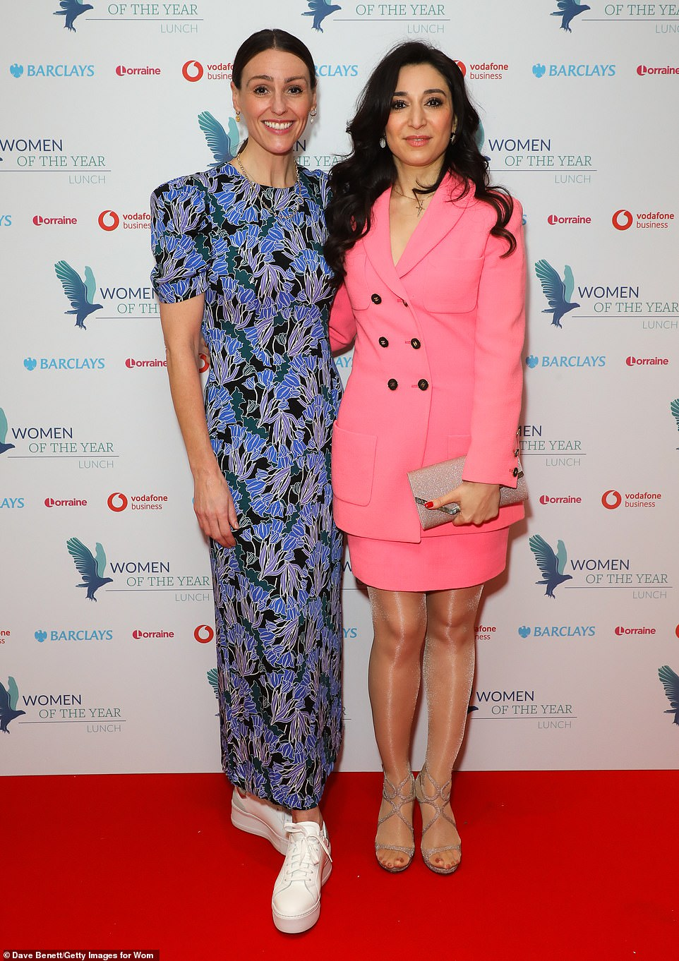 Stylish:Ensuring she claimed her own share of the limelight, Suranne, 43, opted for a form-fitting blue floral dress with peaked shoulders and an ankle length cut as she posed for a photo alongside Heba Bevan,winner of the Vodafone's Women of the Year Innovation Award