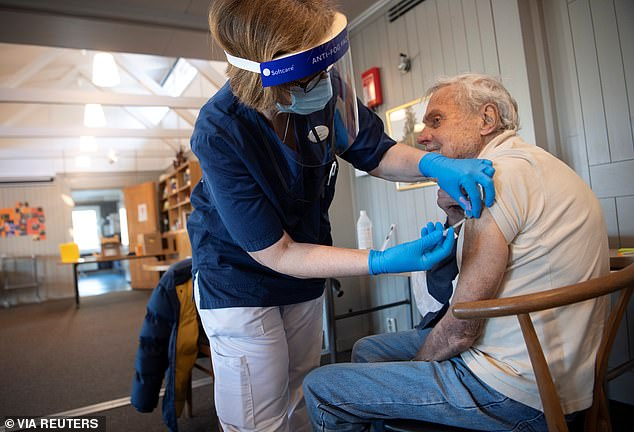 Experts agree that herd immunity targets 80% of the population with immunity to the virus, although emerging strains of the virus may set that number higher.  Image: A man in Stockholm, Sweden receives a shot of a COVID-19 vaccine in March 2021