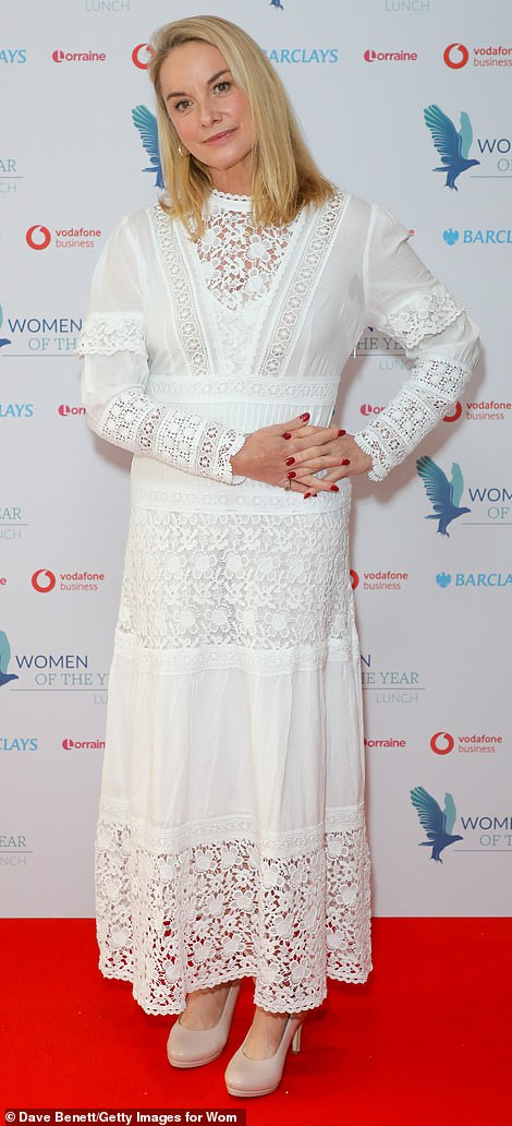 Looking good: Tamzin Outhwaite looked stunning in a semi-sheer white dress with intricate lace detailing as she greeted onlookers ahead of this year's lunch