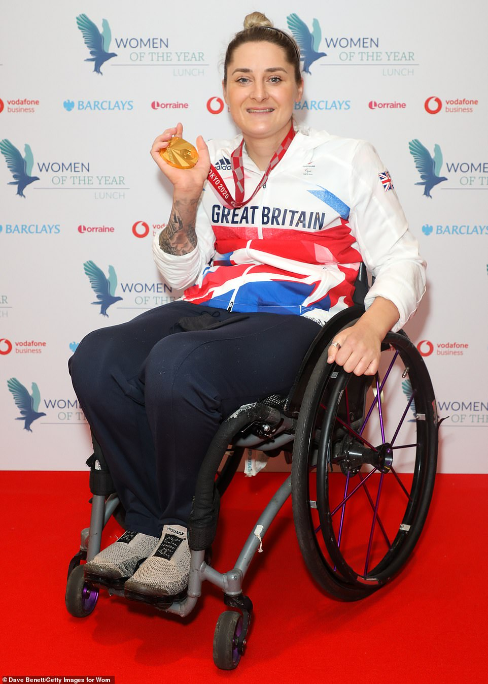 All mine: British para-athlete Kylie Grimes poses with her award following Monday's ceremony