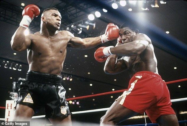 Image: Frank Bruno takes on Mike Tyson for the WBC, WBA and IBF heavyweight titles on February 25, 1989 in Las Vegas