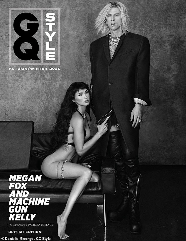 Provocative: For the cover shoot, the actress, 35, wears nothing but a gun holster in one photograph, as she kneels before her rocker beau, 31, who dons thigh-high leather boots