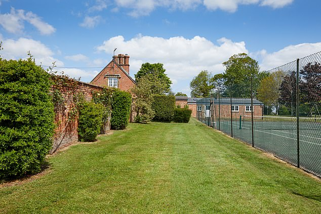 The Grade II listed manor house comes complete with ten bedrooms, five bathrooms, seven reception rooms, a tennis court, a swimming pool and stables