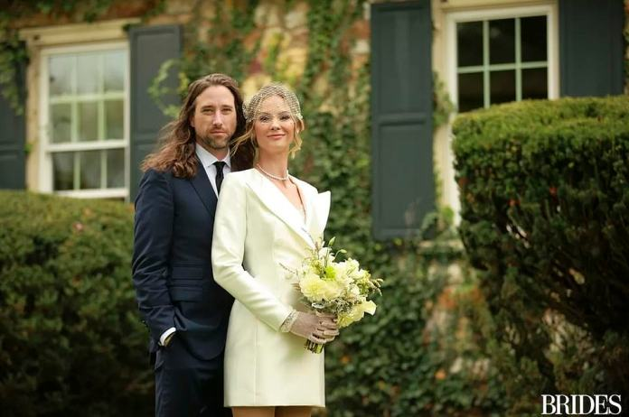 They tied the knot on the lawn in front of Owens' childhood home. King opted for a blazer from Rasario instead of a traditional wedding dress and Owens went for a blue Ralph Lauren suit