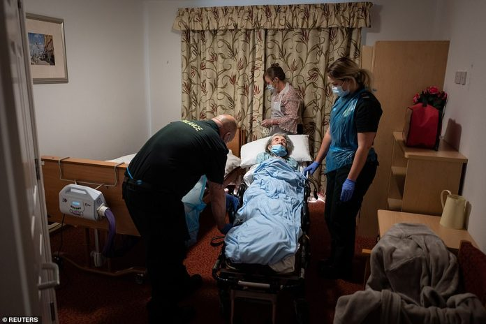The first major investigation into the COVID crisis has concluded that thousands of care home residents died unnecessarily in the pandemic.  Image: Mike Carr and Katie Foloit-Powell of South Central Ambulance Services' Patient Transport Services help settle an elderly non-COVID-19 patient into a care home after being taken from hospital near Portsmouth.