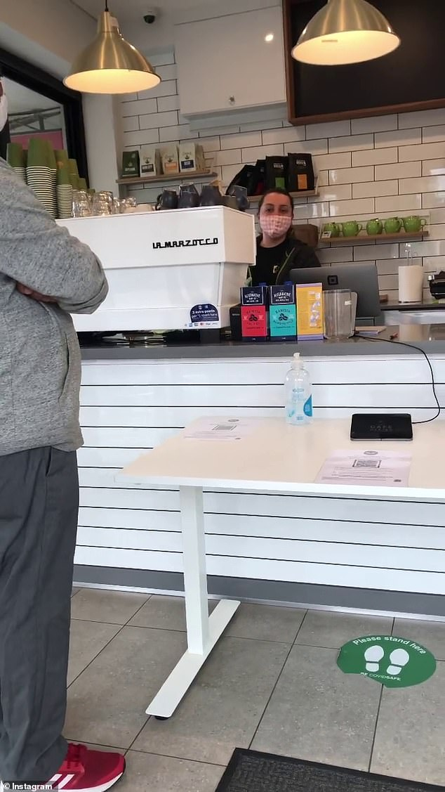 The man posted the video of him launching into a furious spray at a bewildered Andrassa Kest atCafe Dzajko in Tempe on Monday