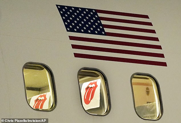 Iconic: The group's famous symbol - the 'Hot Lips' - could be seen through the plane window, as it adorned a seat cover.