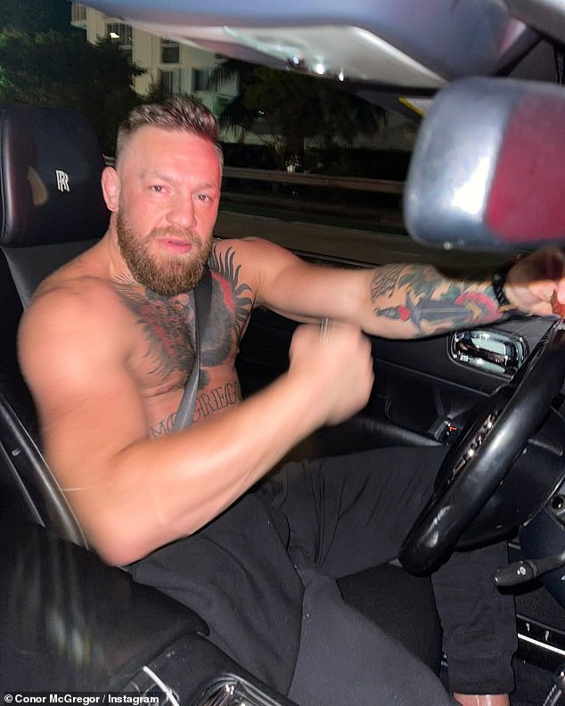 Physique: The 33-year-old MMA fighter went shirtless for his Floridian drive, eager to draw attention to his impressive biceps