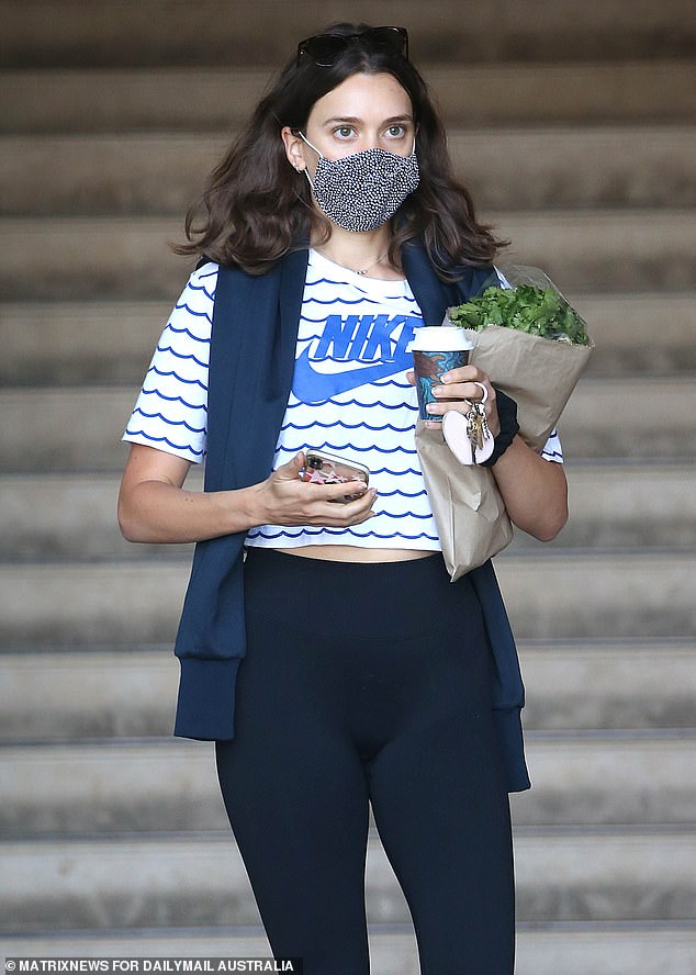 Buying a coffee while wearing a mask and obeying health regulations is seemingly not that hard (pictured, a woman following the rules in Bondi)