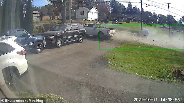 The high-speed crash sent the blue sedan careening into a telephone pole while the stolen truck drifted across a residential driveway in Endwell, New York