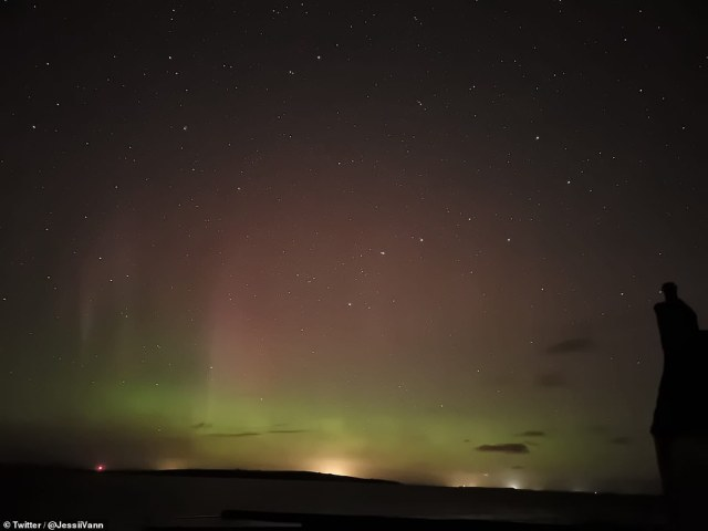 The organizations originally said that Coronal Mass Ejection (CME) - a massive emission of plasma from the outer layer of the sun - would reach Earth by 5 pm BST (12pm EST) tomorrow.  Photo: Northern Lights over Scotland last night.