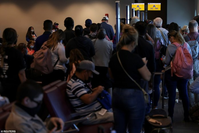 Passengers wait to board a Southwest flight at the airport in El Paso, Texas, on Monday