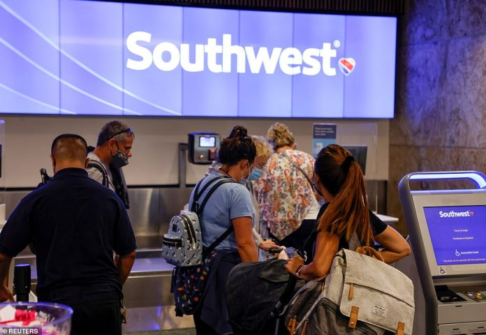 Passengers check in for a Southwest Airlines flight at Orlando International Airport in Orlando on Monday