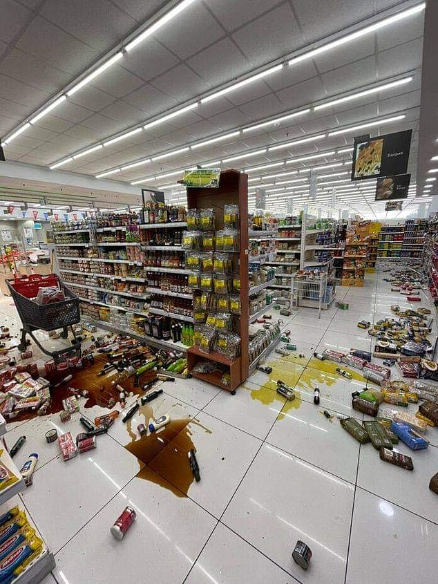 The earthquake shook the shelves of supermarkets (pictured), causing smashed items to lay on the floor
