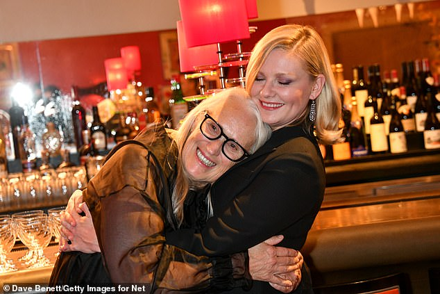 Sweet: Jen and Kirsten warmly embrace after watching new flick