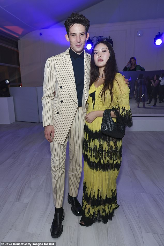 Everything okay? Josh also posed with painter Faye Wei Wei