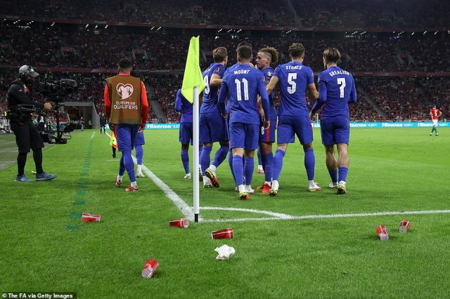 Fans threw cups at the England players after Sterling scored in a dominant 4-0 victory