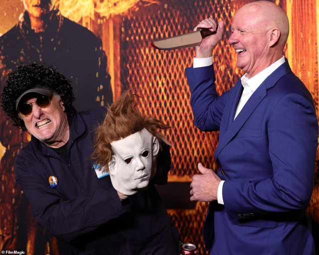 Having a ball: Nick Castle (left), who played serial killer Michael Myers in the original Halloween, had a playful moment at the premiere with James Jude Courtney (right), who plays the role in Halloween Kills