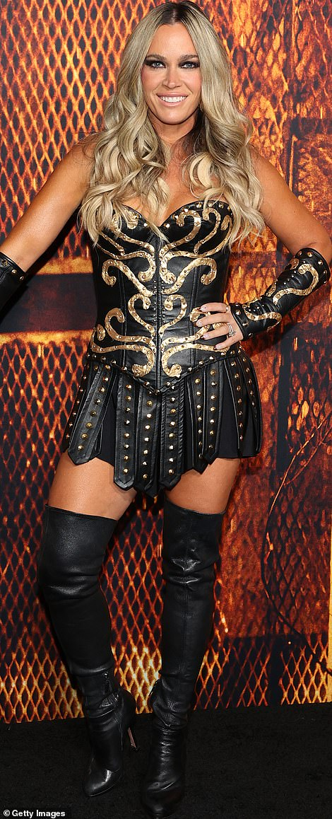 When you got it: Teddi Jo flaunted her legs and cleavage in a busty take on a gladiator outfit, balancing expertly on a sky-high pair of black thigh-high stiletto boots