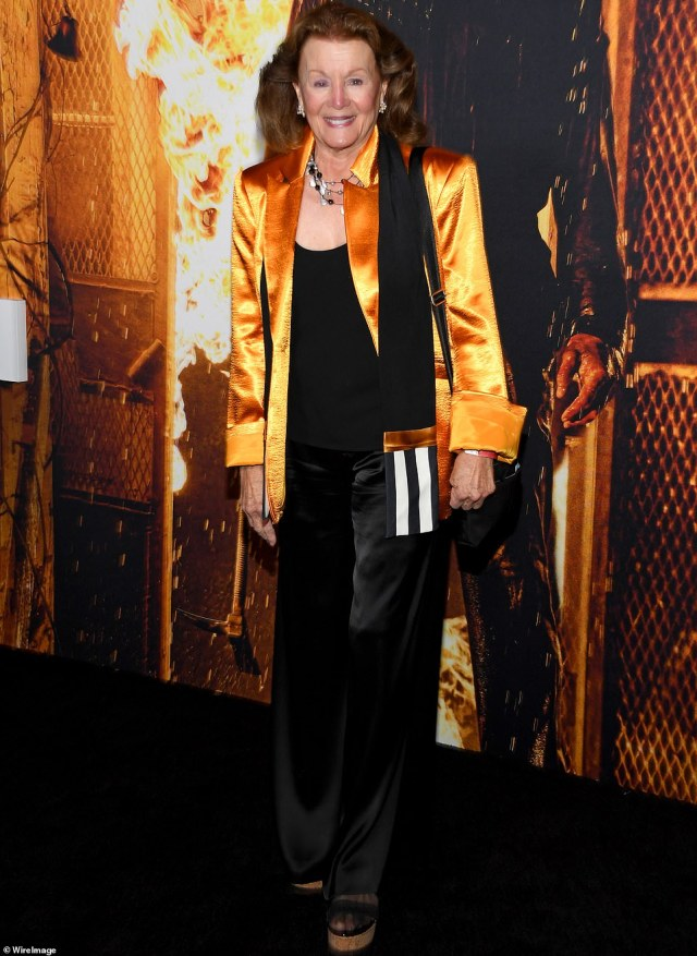 Sleek and chic: Another cast member of the film Nancy Stephens appeared not to be in costume but still clove to the Halloween theme by opting for an elegant orange jacket