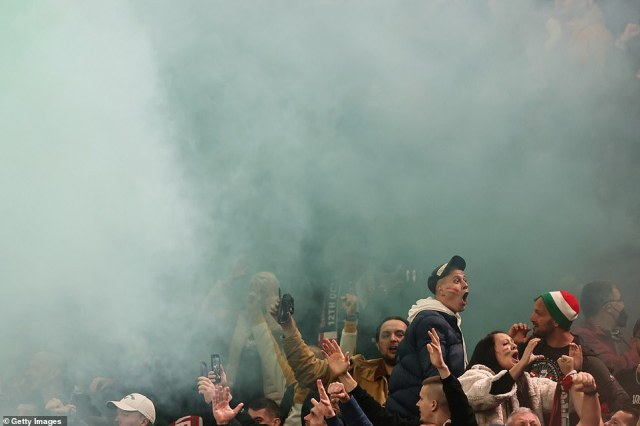 Some of the Hungarian supporters were barely visible for a time amid the haze of smoke from the flare