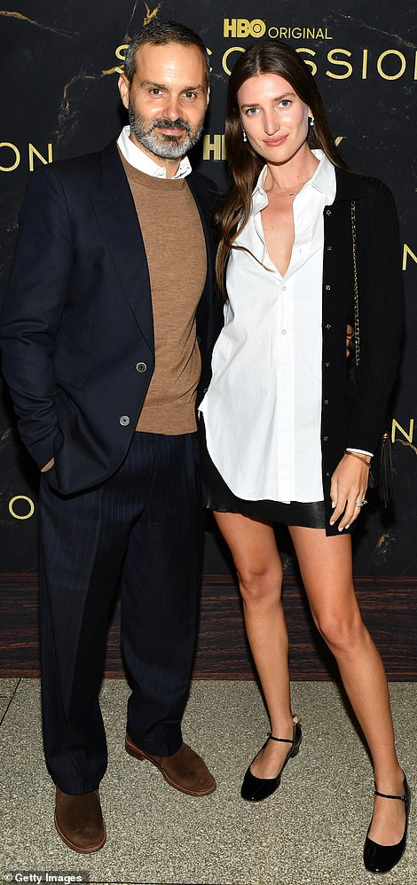 Cozy: Ned Benson and his date for the night Michelle Ouelle struck a cozy pose on the carpet, similar to that of Andrew Ross and his wife Pilar Queen