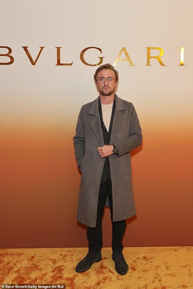 Magic: Harry Potter star Tom Felton looked smart in a grey woollen coat