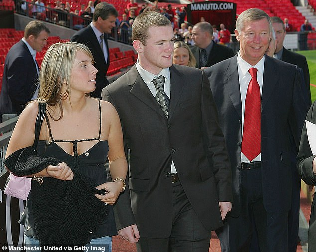 Interesting: Lizzie said former Manchester United manager Alex Ferguson 'encouraged footballers to marry early to keep them off the front pages' (Wayne, Coleen and Ferguson pictured in 2004)