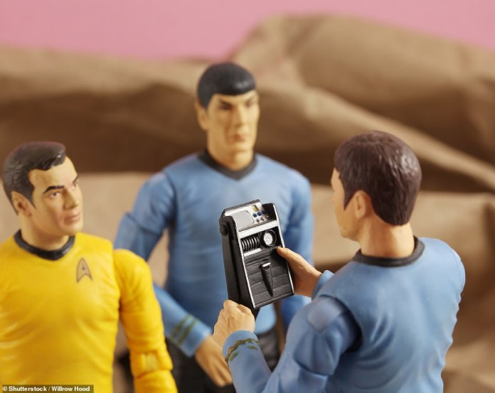 Jeff Bezos was making his own, home-made version of the Tricorder and Communicator toys, like the one held here by an action figure wearing the original series uniform