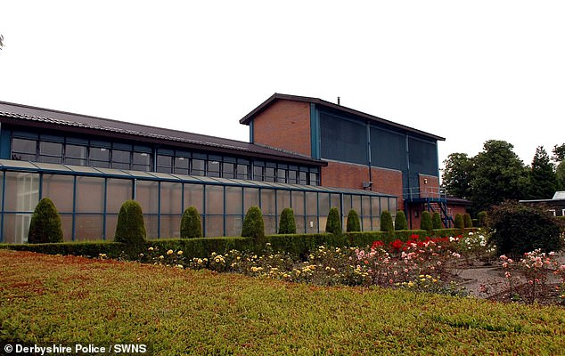 The criminals were caught on camera jumping over the fence at HMP Sudbury (pictured) in Derbyshire at around 10.15pm
