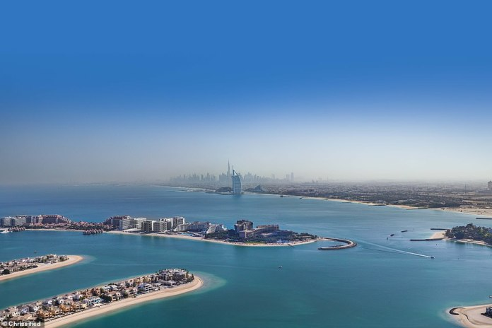 The Burj Al Arab (pictured centre rear) features in the north-facing view from the pool, which is a staggering 200m (656ft) above the ground