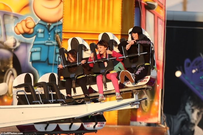 Fun times in the sun: The brood all seemed to be in high spirits as they enjoyed a high-octane thrill ride