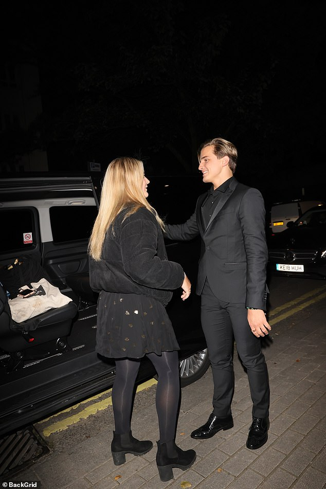 Sleek: The daughter of celebrity chef Gordon Ramsay, 19, wore a black dress, matching jacket, tights and ankle boots