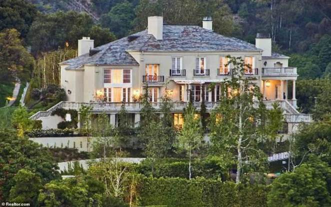 Musk began his grand sell-off with a 20,200-square-foot mansion in Bel Air (pictured) for $29million in June 2020
