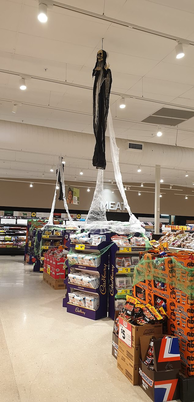 A mum-of-three has slammed Woolworths over its 'inappropriate' Halloween decoration after her kids were left frightened when they spotted a skull figure floating near the meat aisle
