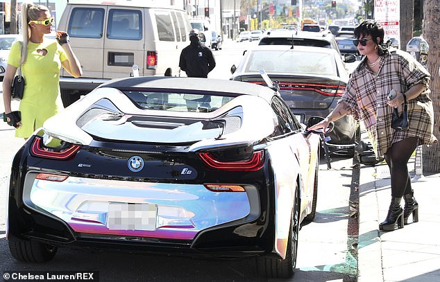 Well suited: In a YouTube video about having the holographic wrap added to the BMW the hotel heiress vamped: 'If I were a car this would be me'