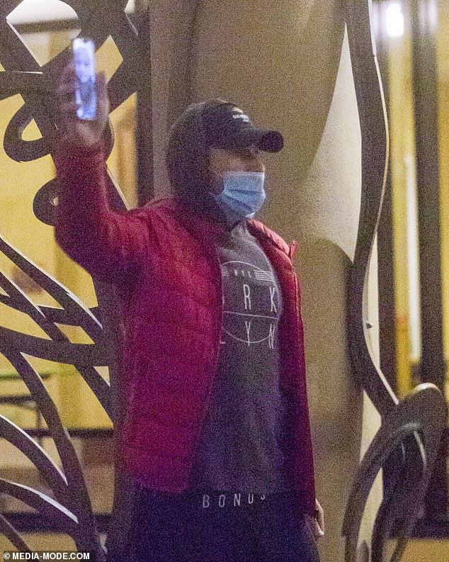 Show and tell: At one point, he was spotted holding up his phone so that the person he was FaceTiming could see a glimpse of his surrounds