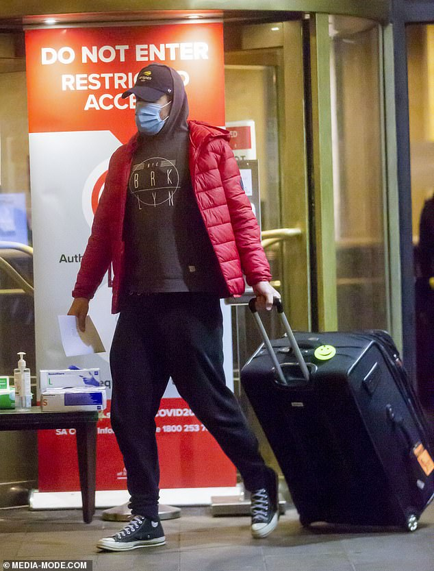 Snug: He completed his look with a pair of black track pants, black-and-white Converse sneakers