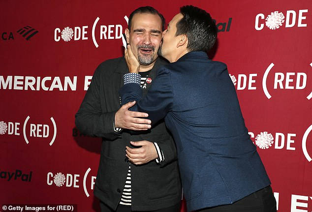 Reunited!  Tony's winner, 41, beamed for the solo cameras, before planting a kiss on Hamilton and In The Heights star Javier Munoz's check.