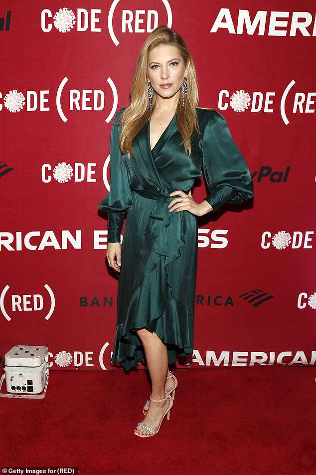 Elegance: Big Sky's Katheryn Winnick exuded elegance in a silky green wrap dress.  puffed sleeves and plunging neckline