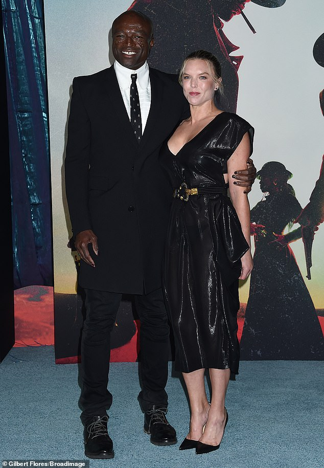 Couple: Seal, from London, 58, looked dapper in a black frock coat with a white shirt and tie, as well as black jeans and black brogues.  He was accompanied by his girlfriend Laura Strayer