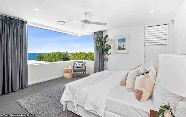 The master suite awaits upstairs and opens via bi-fold windows to capture the magnificent blue hues of the ocean and breeze