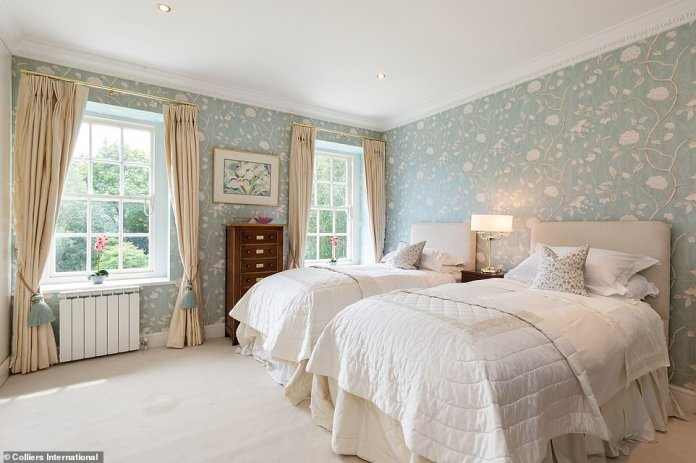 Each of the property's six bedrooms - one of which is pictured - features en-suite bathrooms