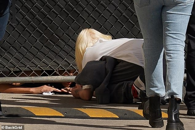 Dedicated: Not wanting to miss out on meeting her fans, Billie crouched down to greet them